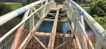 Mantención de puente que une costaneras de laguna